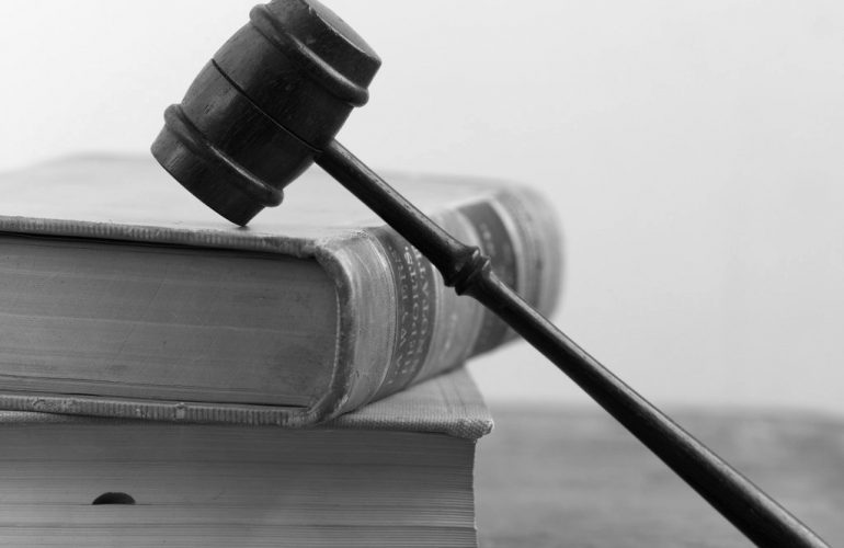 a judge's gavel on law books